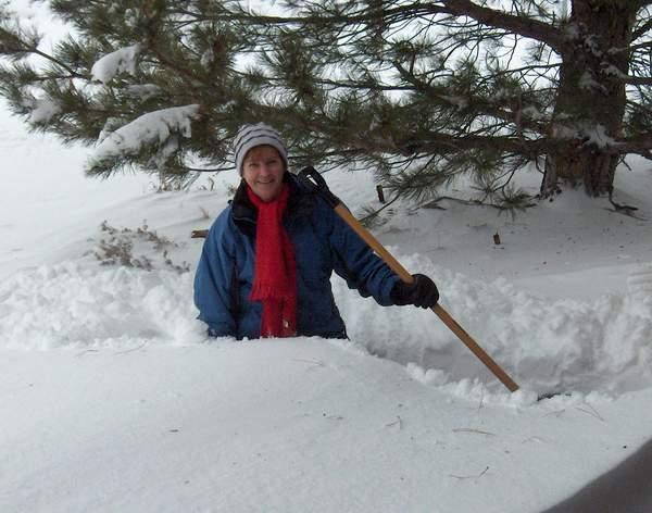 Terri shoveling snow
