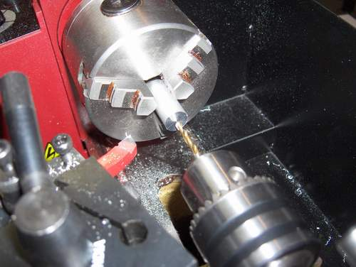 Lathe with drill